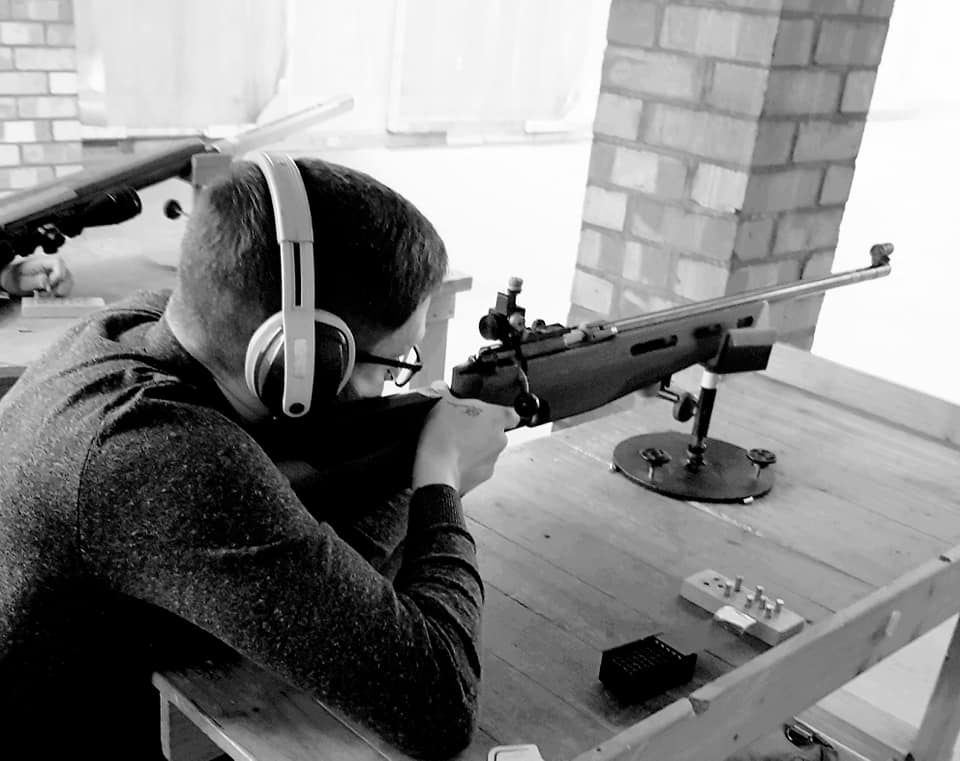 A novice takes aim with a rested smallbore rifle