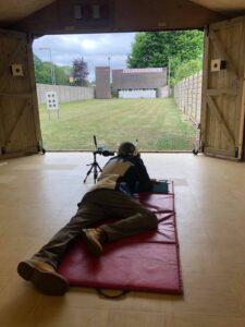 A shooter firing from the fifty metre firing point in the new training building