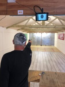 An athlete shooting Air Pistol in the new Training Building